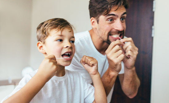 father son flossing