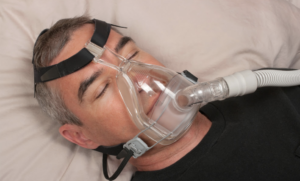 man sleeping with CPAP on